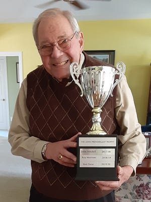 Fairfield Harbour resident Bob Ostar was pleased to be the recipient of the John Prendergast Trophy in this year's Marathon Bridge tournament. Bob had been John's partner before John's passing. [CONTRIBUTED PHOTO]
