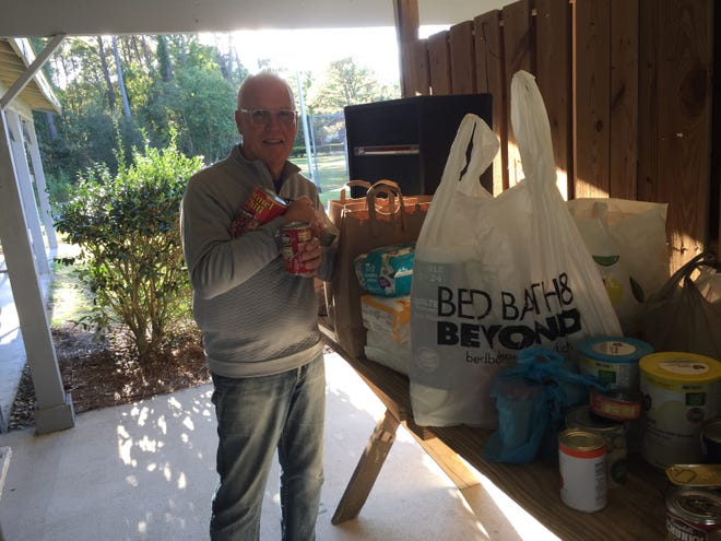 Craig Rosindale, organizer of the newly created Fairfield Harbour Inclusion Group, appreciated the generosity of community members who attended the second meeting of the group and shared canned goods as part of their Fairfield Cares commitment. [CONTRIBUTED PHOTO}