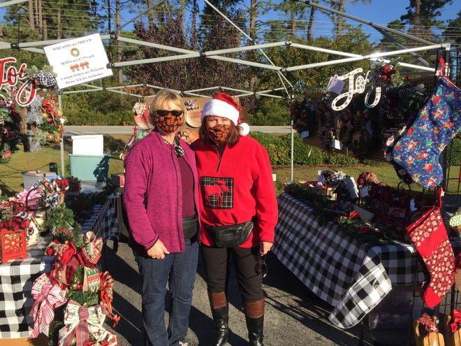 Fairfield Harbour crafters, Barbara Lewis and Linda Neylan, enjoyed the sunshine and extra space provided when the annual Craft Fair moved outdoors to the Community Center parking lot. [CONTRIBUTED PHOTO}
