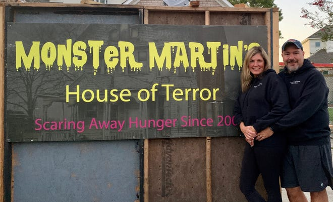 Fairfield Harbour residents Faith and Jon Martin prepare for their first Monster Martin's House of Terror in their new home. The haunted house was open for viewing in late October. Entrance fees and canned food donations will benefit Religious Community Services in New Bern. [CONTRIBUTED PHOTO]