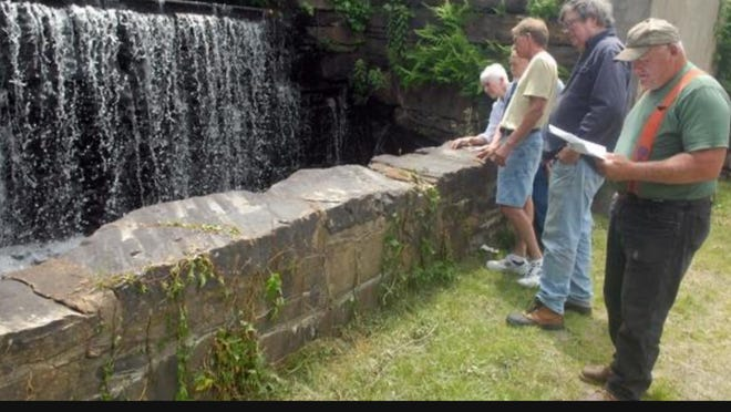 Visitors at the Acme Pond Dam in East Killingly in 2014. The dam is one of five being proposed for donation to the town.