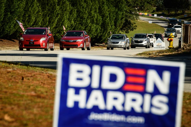 The 'Ridin' with Biden for Our Military' car parade heads to the Spring Lake Recreation Center, an early voting site, on Monday.