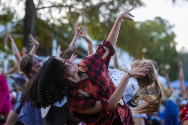 The Danscompany of Gainesville, shown performing at the annual Boo at the Zoo event in 2019, will perform a Halloween Trilogy once per hour on Friday from 6 to 8 p.m. at the Celebration Pointe. [FILE]