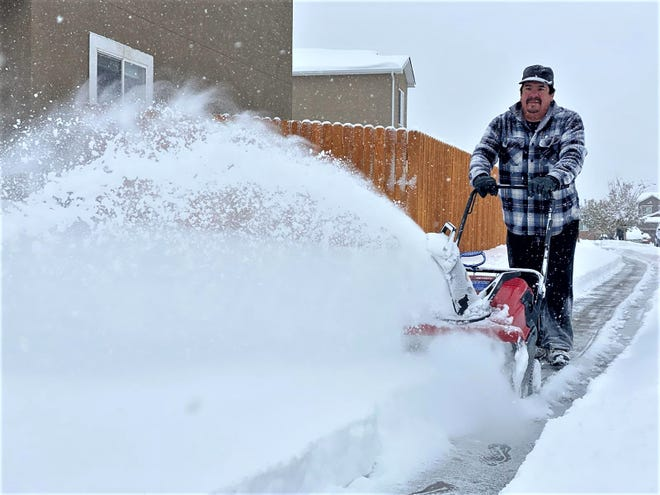 Joe Cortinas helps neighbors clear sidewalks in the Southpointe neighborhood on Pueblo's South Side.