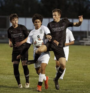 Gerardo Guzman (center) was one of 10 seniors on the Westland boys soccer team. The Cougars finished 3-12-2 with a 4-1 loss at Olentangy on Oct. 20 in the first round of the Division I district tournament.