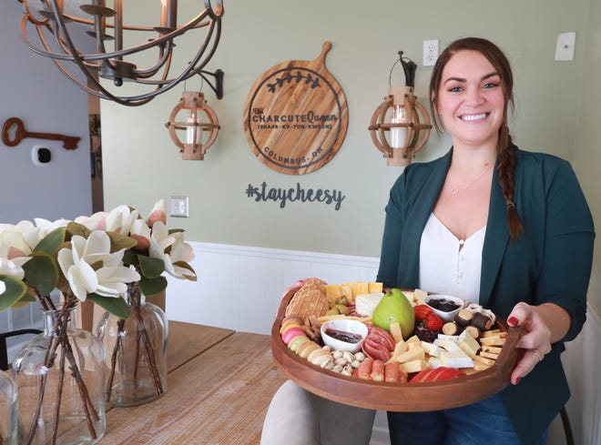 After being laid off during the COVID-19 coronavirus pandemic, Lauren Simon went to visit friends and created a charcuterie board for them. A few days later, somebody asked her make another one, so she started a business, the CharcuteQueen.