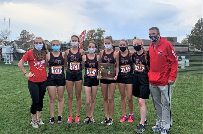 The Liberty Union girls' cross country team won the Central District Division III Section 2 district title on Saturday at Hilliard Darby High School. Members of the team are, from left to right: Assistant Coach Brittany Schmauch, McKenzie Schmauch, Natalie Cotton, Alison Sponseller, Jasmine Roach, Jayden Roach, Rachel Miracle, and head coach Jason Roach