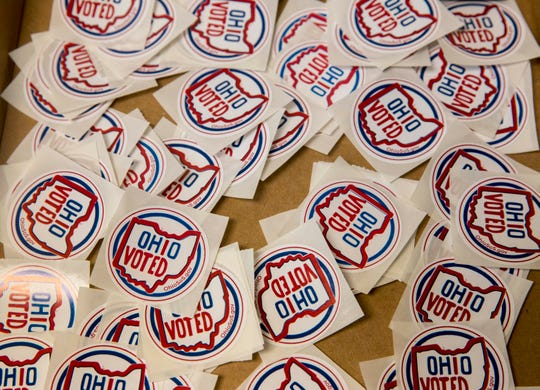 Voting stickers rest in a box at the exit of the Hamilton County Board of Elections early voting facility in Norwood.