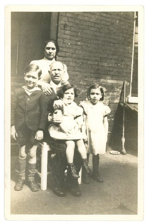 Michael and Augusta Delmonico pose with their three youngest children, from left to right: Frank, Ruth and Rose Mary. Frank was one of two Delmonaco sons killed overseas in 1945.