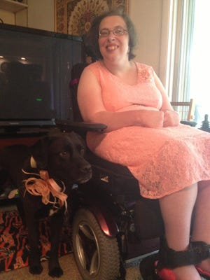 Susan Koller, board member of Disability Rights Ohio posing with her pooch.