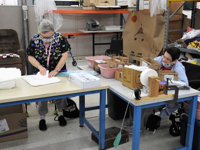 Sharon Levengood and Linda Charnock do assembly work at Hopewell Industries. The facility is moving to a new, smaller site. Flooding issues need to be resolved in the new building so Hopewell can use it for product storage for the assembly workshop.