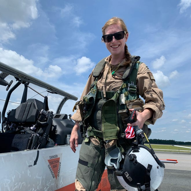 U.S. Navy Lt. Rhiannon Ross, an instructor pilot, stands in front of a T-6B Texan II primary flight trainer aircraft at Naval Air Station Whiting Field in Milton, Fla. Ross and U.S. Coast Guard Ensign Morgan Garrett, a student naval aviator, died Oct. 23, 2020 when their aircraft crashed in Foley, Alabama.