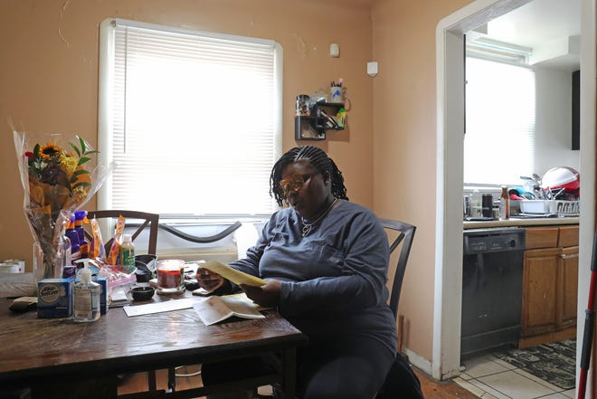 Tamika Denson talks about her over assessed home in Detroit on Sunday, October 25, 2020. She has struggled to pay her tax bill and now risks foreclosure over back taxes.