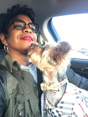 Erica Hill takes her 2-year-old dog, Kash, a Yorkshire Terrier to Canine to Five dog day care daily. Hill works for the City of Detroit and keeps long hours. She wouldn't be able to do her job without the dog day care, she said.