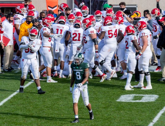 Michigan State wide receiver Jalen Nailor walks away as Rutgers celebrates an interception late in the fourth quarter.