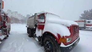 Fires' fury calmed by more than a foot of snow