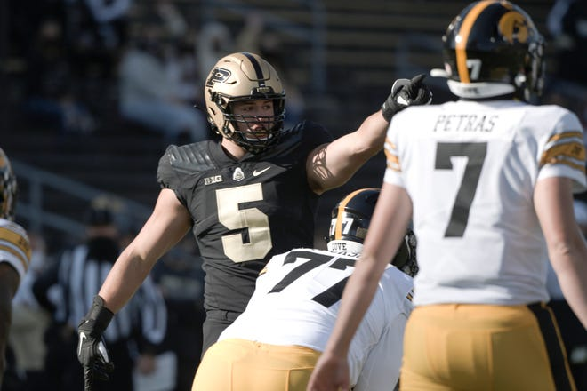Purdue defensive end George Karlaftis (5) motions during an NCAA college football game in West Lafayette, Ind., Saturday, Oct. 24, 2020.