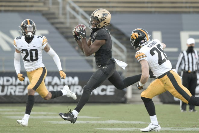 Purdue wide receiver David Bell (3) catches a pass during an NCAA college football game in West Lafayette, Ind., Saturday, Oct. 24, 2020.