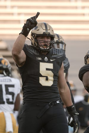 Purdue defensive end George Karlaftis (5) reacts during an NCAA college football game in West Lafayette, Ind., Saturday, Oct. 24, 2020.