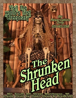 An ad for The Shrunken Head bar in downtown Manitowoc.