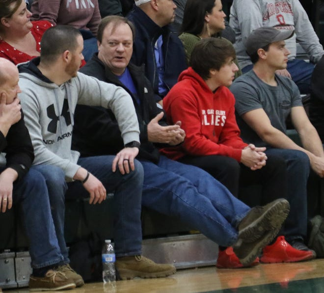 Basketball coach John Kurtz takes in a tournament game at Madison last season. Kurtz returns to the bench in 2020-21 as he became the new head coach at Crestview High School.