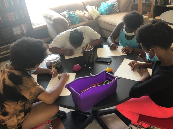 Children at Glenbrook Apartments, a CommonBond affordable housing community, work on art projects to express their feelings during the pandemic.