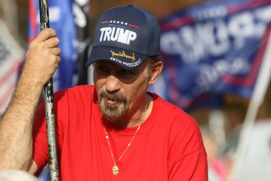 Organizers, David Crouse with other supporters of President Donald Trump as they participate in a flag wave along a highway in Pottsville in Schuylkill County, Pennsylvania hope to get the president re-elected.