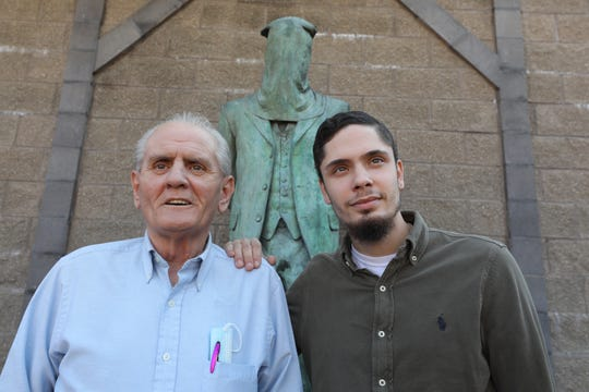 Dennis Wiessner and his son Ben at a monument dedicated to Irish immigrants who were hung in Mahanoy City, Pennsylvania in the 1800's. Supporters of President Donald Trump in Schuylkill County, Pennsylvania hope to get the president re-elected.