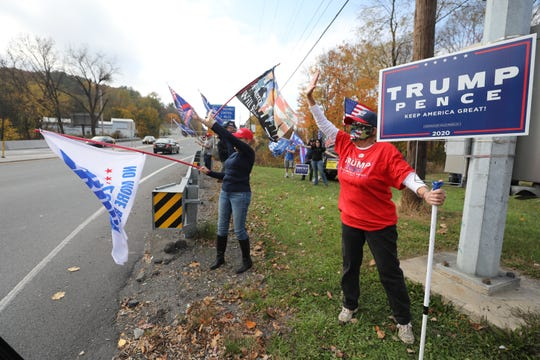 Supporters of President Donald Trump participate in a flag wave along a highway in Pottsville in Schuylkill County, Pennsylvania hope to get the president re-elected.
