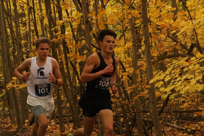 Senior Jake Bulat (front right) competes at the Pre-Regional meet.