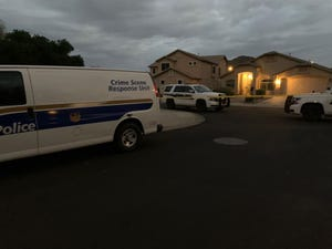 Phoenix police respond to a Phoenix home on Sunday where two officers shot and killed a man they said announced he had a gun and pointed an object at them, which they later learned was a glasses case.