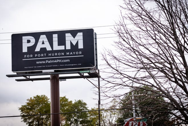 A billboard supporting DJ Palm's run for mayor stands above Military Street in downtown Port Huron.
