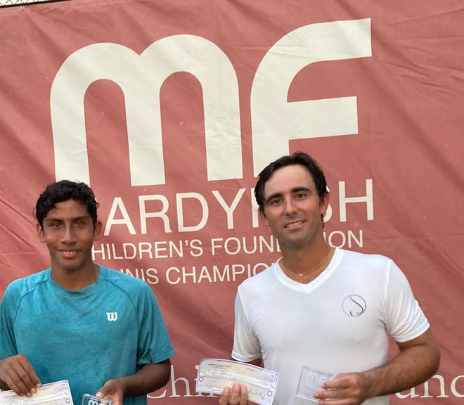 Diago Hidalgo, winner of the 2020 Mardy Fish Tennis Tournament Championship, with runner-up Matthew Segura on Sunday in Vero Beach.