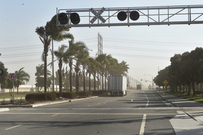 Strong winds kick up dust along Hueneme Road in Oxnard in October as the Santa Ana Winds blew through the area. The National Weather Service forecasts the dry winds to again blow through Ventura County starting Wednesday and lasting through the weekend.