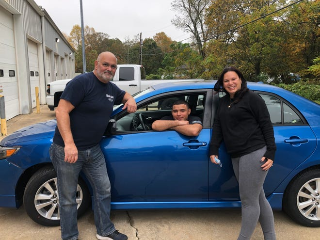 Gene Mainiero of Main Auto Service (left) and Ruby Rodriguez of Millville (right)  partnered to surprise Army Pfc. Chris LaPortez of Atlantic County by fulfilling his wish to refurbish the car that belonged to his mom, Rosa Quinones, who died in 2015.