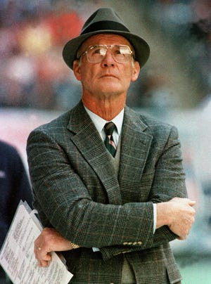 FILE - In this Dec. 18, 1988, file photo, Dallas Cowboys head coach Tom Landry watches from the sideline during an NFL football game against the Philadelphia Eagles in Irving, Texas.New England Patriots coach Bill Belichick may seem like one-of-a-kind, and he will set himself apart with a win Sunday in Super Bowl 51, which would make him the first coach to capture five Super Bowl rings. But he has much in common with Tom Landry, Chuck Noll, John Wooden and any other coach to put himself among the Mount Rushmore of the best to ever run a team. (AP Photo/Ron Heflin, File)