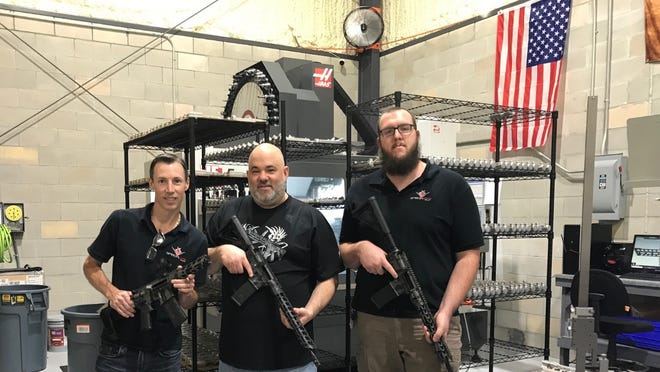Garrett Porter, left – owner and founder of Special Ops Tactical – with two fellow machine gun manufacturers, Jimmy and Nate. Porter said his company, which usually sells between 5,000 to 9,000 AR-15s a year, has sold 20,000 semi-automatic rifles and machine guns so far in 2020 and enough parts to make 10,000 more.
