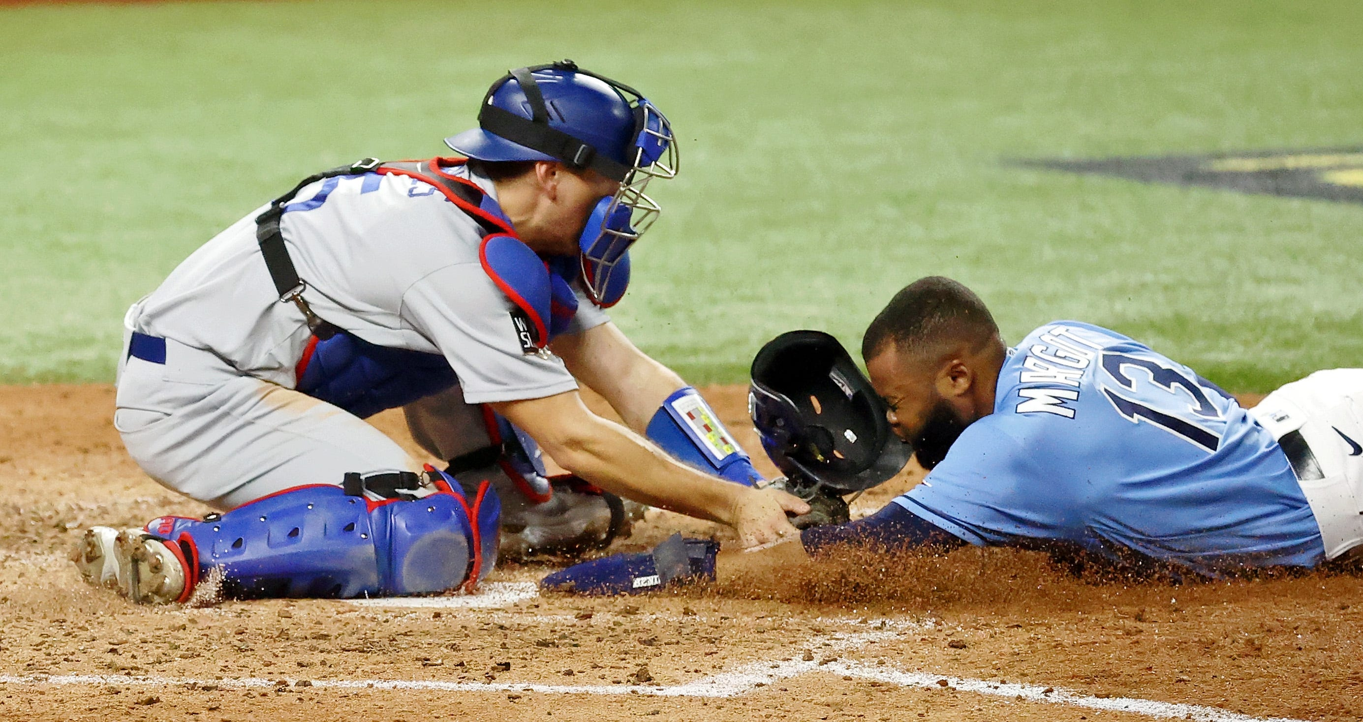Rays' Manuel Margot tries to steal home on Clayton Kershaw in Game 5 of World Series