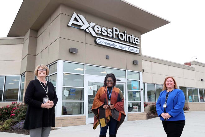 Certified application counselors Lori Jensen, Cinnamon Young and Heather Gunnoe ay AxessPointe Community Health Center in Akron, where they help people apply for Affordable Care Act plans.