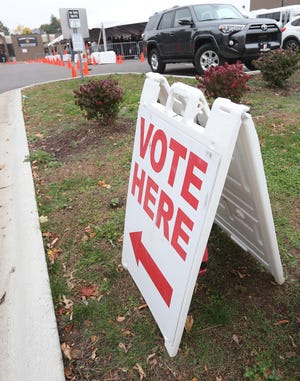 Voters are directed to the Early Voting Center at the Summit County Board of Elections Tuesday, Oct. 27, 2020 in Akron, Ohio.