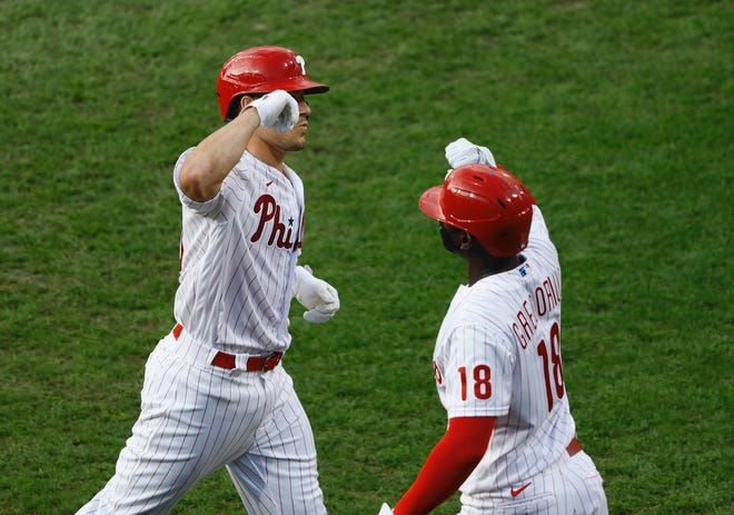Phillies catcher J.T. Realmuto, left, and shortstop Didi Gregorius celebrate a Realmuto home run.