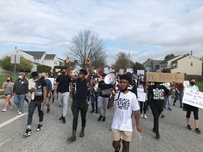 Darnell Hightower, a senior and captain of the Cherokee High School football team, leads a Black Lives Matter protest through Evesham Township on Oct. 24.