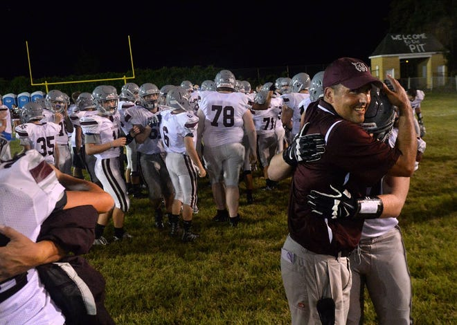 Beaver coach Jeff Beltz celebrates with one of the Bobcats after a 2016 win at Aliquippa.