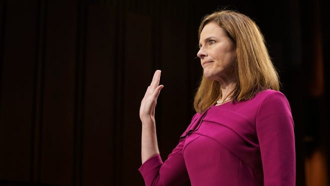Supreme Court nominee Amy Coney Barrett is sworn in Monday during a confirmation hearing before the Senate Judiciary Committee on Capitol Hill in Washington.