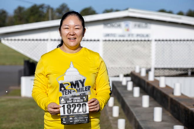 Staff Sgt. Chang Yang, a motor transport operator assigned to Headquarters and Headquarters Company, 3rd Brigade Combat Team, 10th Mountain Division, holds up her race bib for the 36th Annual Army Ten-Miler, Virtual Edition, Oct. 18, at Fort Polk's Honor Field. Yang began the race at 7 a.m., Oct. 17, and finished within one hour, 47 minutes, 52 seconds.