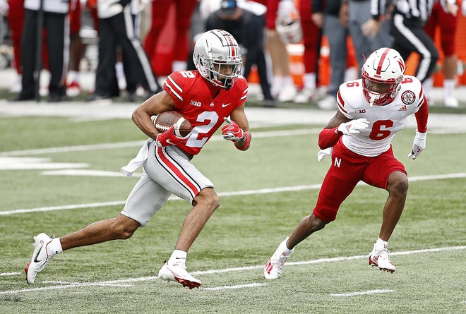 Ohio State receiver Chris Olave had six catches for 104 yards against Nebraska before leaving the game late in the third quarter after absorbing a heavy hit.