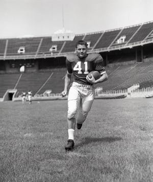 Tom Matte, shown here as a sophomore in 1958, came to Ohio State from Cleveland to play halfback, but injuries at quarterback forced coach Woody Hayes to use him under center in 1959 and '60.