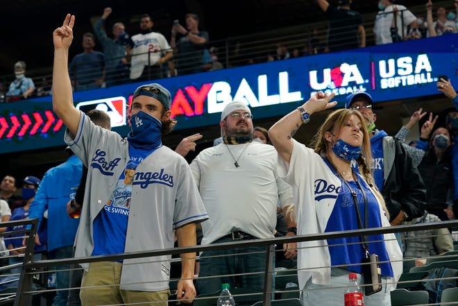 Los Angeles Dodgers fans cheer during the seventh inning in Game 5 of the World Series against the Tampa Bay Rays Sunday at Globe Life Field in Arlington, Texas. (Eric Gay/The Associated Press)