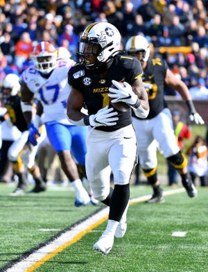 Missouri Tigers running back Tyler Badie (1) runs the ball against the Florida Gators during the second half at Faurot Field last November.