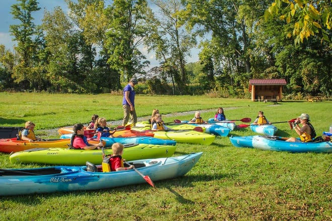 A children's kayaking workshop at the Finger Lakes Museum.